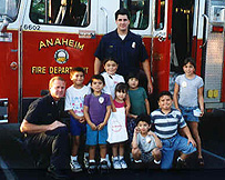 kids with firefighters